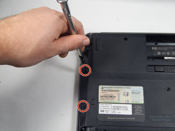 Use the PH0 screwdriver to remove the two 3 mm Phillips head screws in the disk drive port.