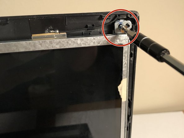 Remove the small silver screws from the 4 corners of the screen with the same screwdriver you have been using. Place them in a safe location.