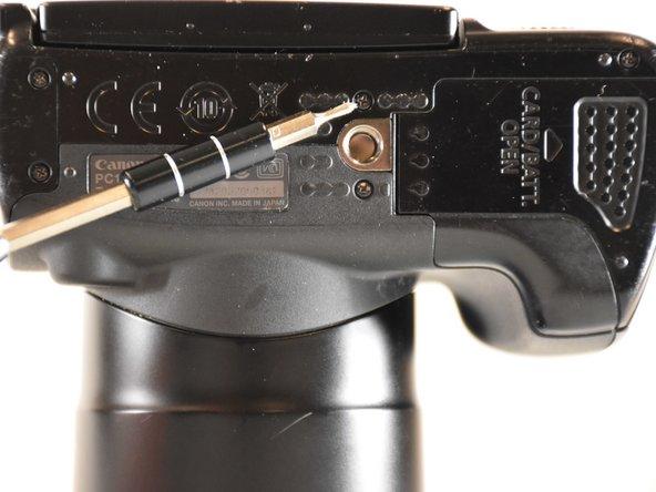 Image 2/2: Unscrew the lone 6 mm screw shown orange