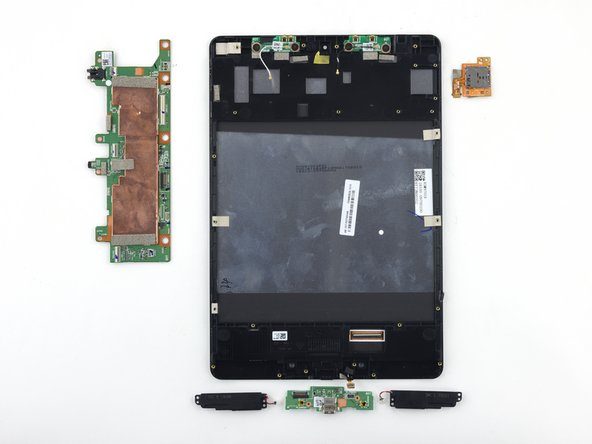 Image 1/1: Components include: modular microSD reader, motherboard, modular speakers, and daughterboard.