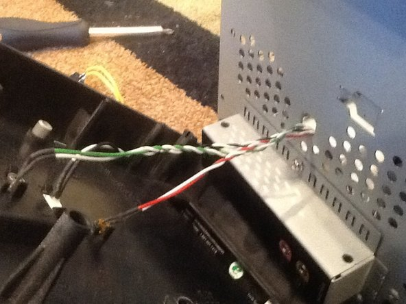 Image 3/3: Don't pull it out too hard, as there are three cables still connected to the panel.