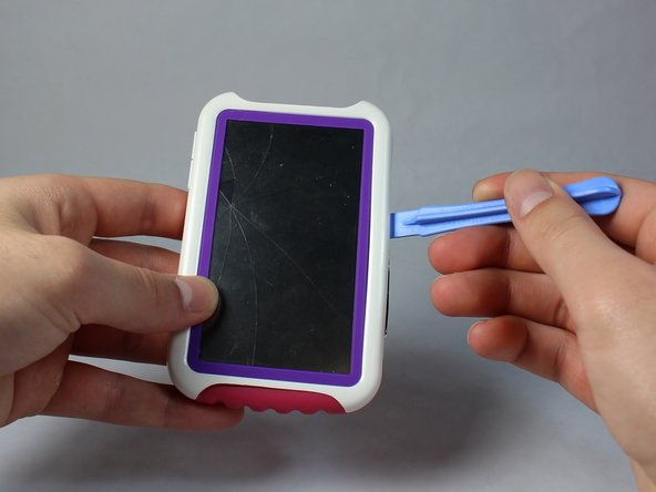 Use a spudger to pry open the case of your device to reveal the inside.