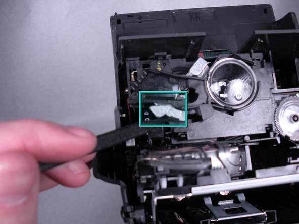 Rotate the shutter mechanism clockwise until it stops.