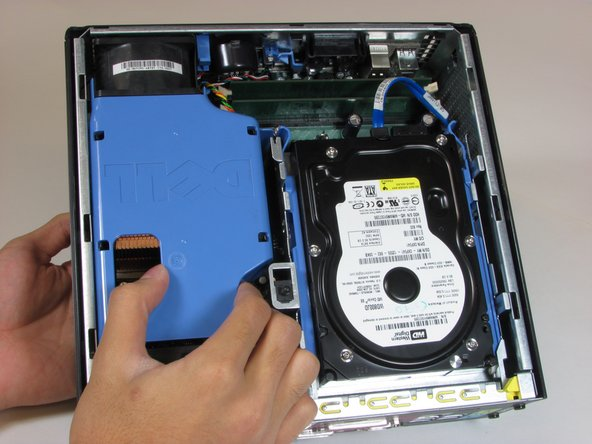 Remove the large blue cover from the computer, there are no screws or tabs keeping it in place.