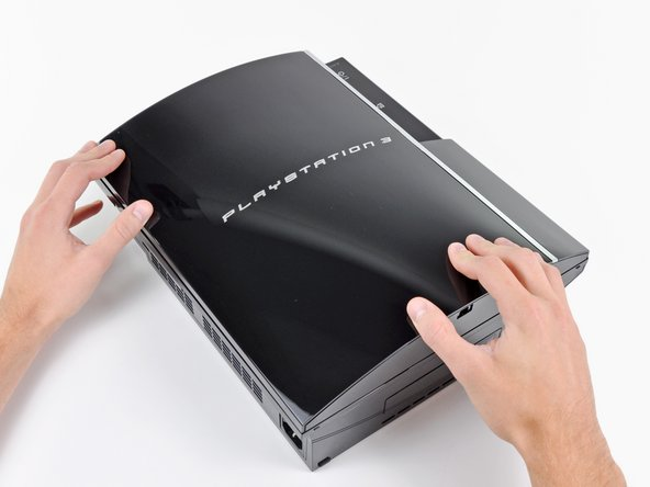Image 1/3: Pull the smart plate toward the hard drive bay, then lift it off the body of the PS3.
