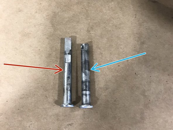 This is the bolt for the Rear mount , notice how it is grooved on one side.