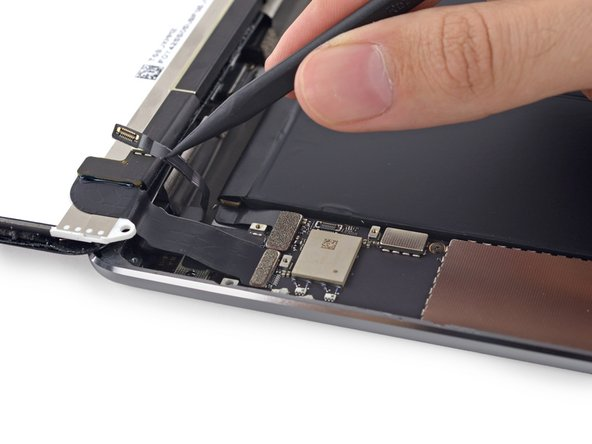 Fold the home button ribbon cable out of the way.
