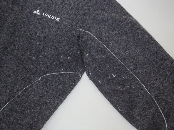 How do I remove pilling from my Vaude pullover?