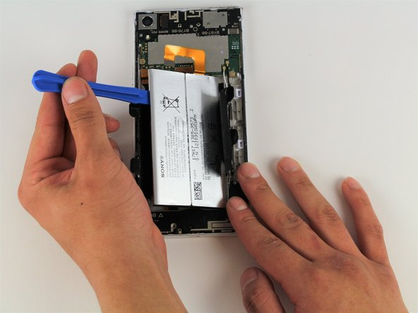 Remove the battery by pulling up on the iFixit Opening Tool.