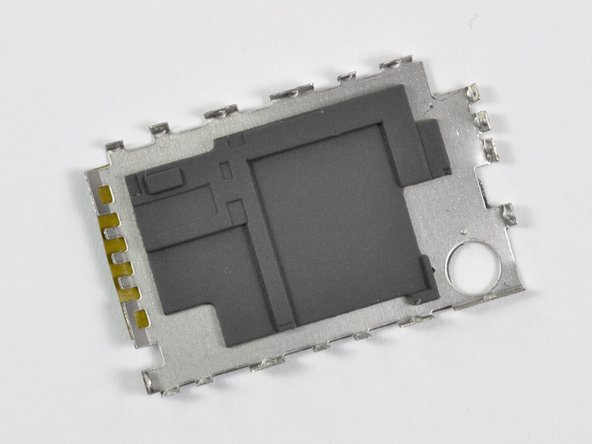 Image 3/3: Apple used custom molded rubber bumpers between the chips and the EMI shields presumably to quell any [link|http://en.wikipedia.org/wiki/Crosstalk|interference] between analog and digital circuitry.