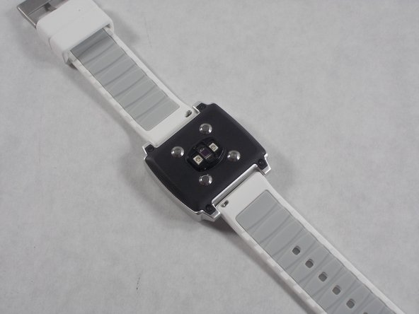 Flip the watch over to view the back panel and sensor. Arrange the watch so that the band clasp is away from you.