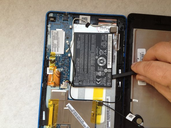 The battery is stuck to the LCD metal frame with a double side adhesive tape. With a plastic tool carefully separate it .