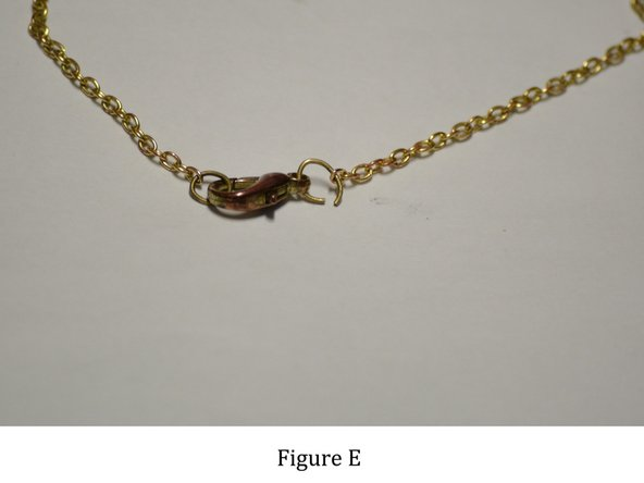 Image 2/2: Figures D and E: While holding the jump ring in one hand and the end of the necklace in your other hand, proceed to loop the chain into the opened jump ring.