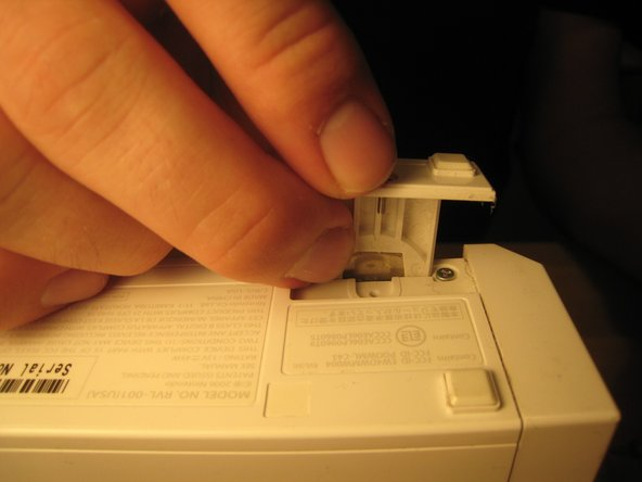 Image 2/3: Once that screw is removed, you can slide out the plastic slot.