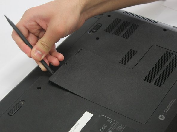 Image 1/2: Pull the panel away from the laptop and set it off to the side.