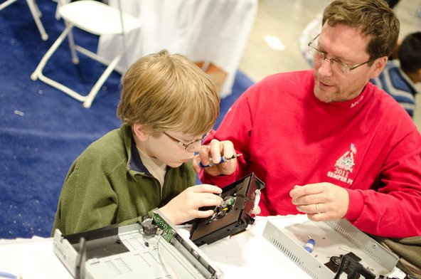 Kid doing repair with a parent