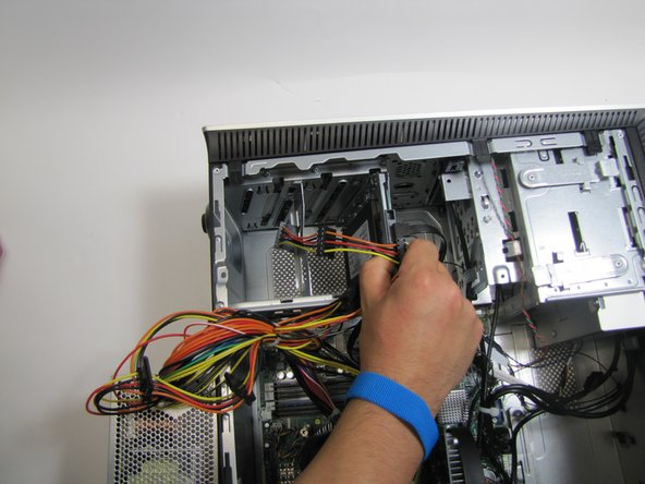Unplug the SATA interface power cable going to the hard drive by pulling straight up.
