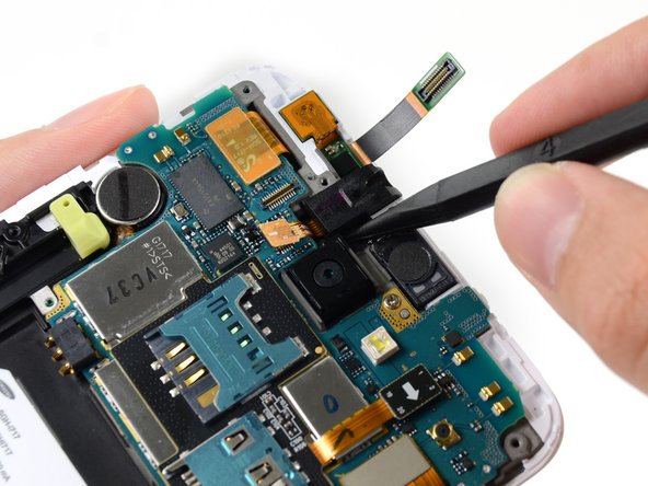 Use the point of a spudger to pry the headphone jack out of its recess in the display assembly.
