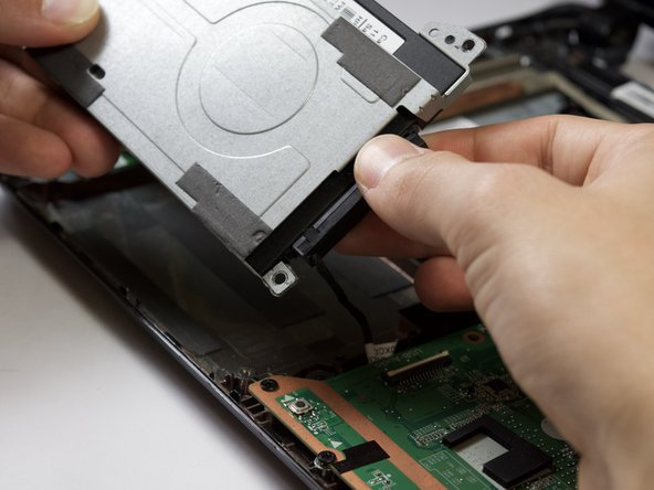 Do not lift the hard drive very high, the connector cable is not very long and may get damaged if you pull too far
