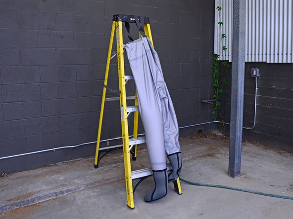 Be sure to pay attention because the large amount of water may tip the ladder. If needed, weigh the back side of the ladder down to prevent it from tipping.