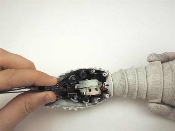 Use a pair of tweezers to remove the motor assembly from the mouth and inspect for any apparent issues.