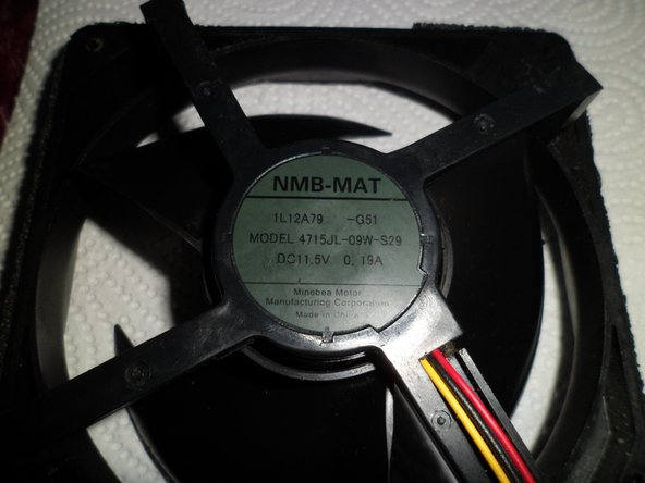 It says: NMB MAT - 1L12A79 - g51 - Model 4715JL-09W-S29 - DC 11.5V - 0,19A - Minebea Motor China ...