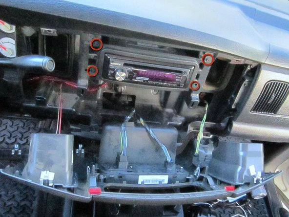 Image 1/3: Locate and remove the four anchoring 12mm long #2 Phillips screws for the head unit using the #2 screwdriver.