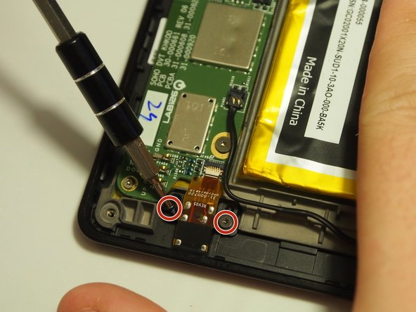 After locating the Aux port at the bottom of the device, remove the (2) 3mm T4 Torx screws.