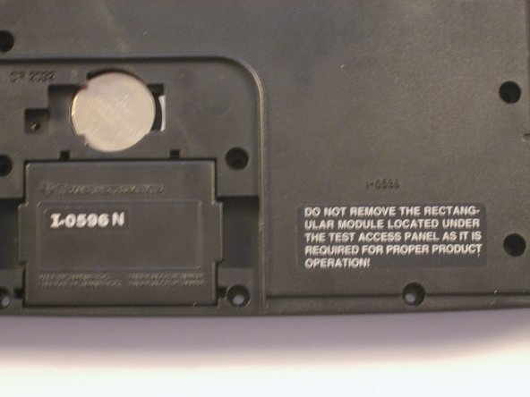 "The warning label next to this module reads ""Do not remove the rectangular module located under the test access panel as it is required for proper product operation!"""