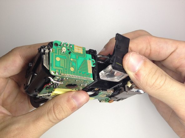 Image 2/2: Pull up to remove the front view finder.