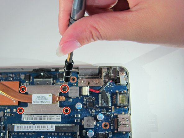 Remove four identical 6mm screws from the heat sink labelled CPU using the J0 screwdriver.
