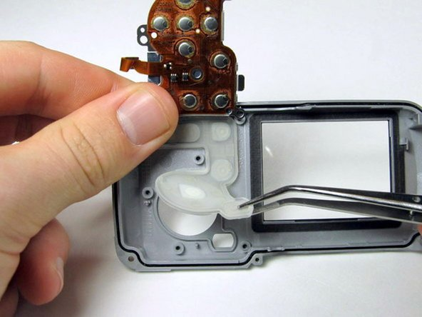Image 2/2: Use the tweezers to remove the back buttons.