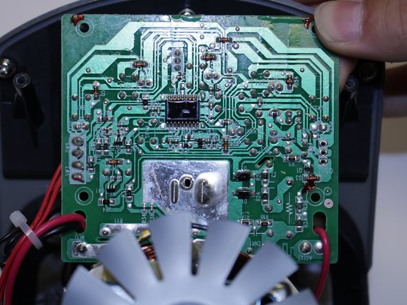 Using the Phillips #2 screwdriver, remove the four screws (10mm long, 5mm wide) on the circuit board.