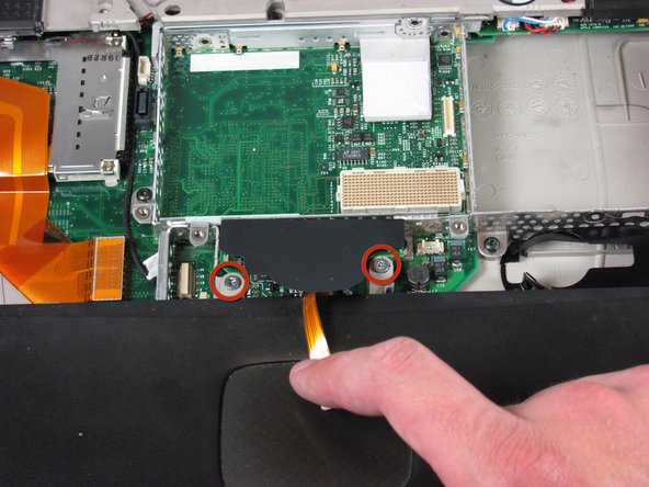 Image 1/1: Disconnect the orange cable from the logic board.