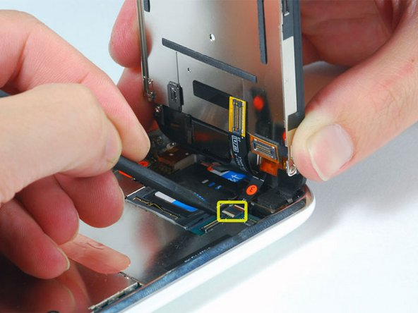 Image 1/1: Slide the black ribbon cable out of its connector, and remove the display assembly from the iPhone.