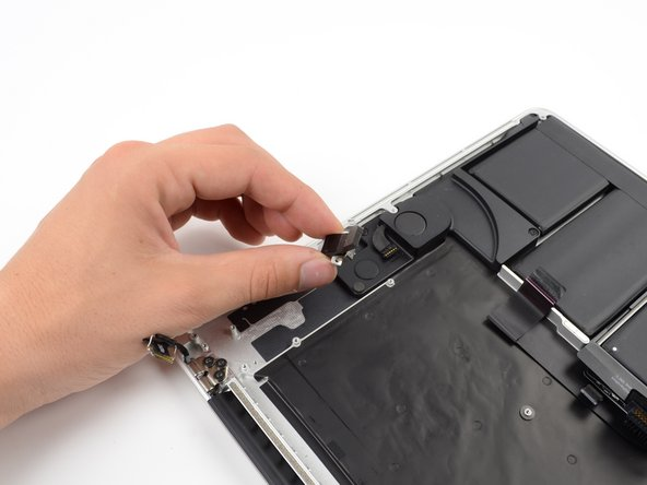 Slide the headphone jack away from the upper case.