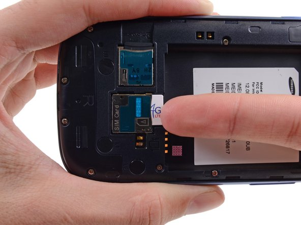 Image 3/3: For reassembly, push the SIM card into the slot until it clicks in place.