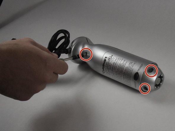 Remove  three 13.3 mm  Phillips PH#2 screws.