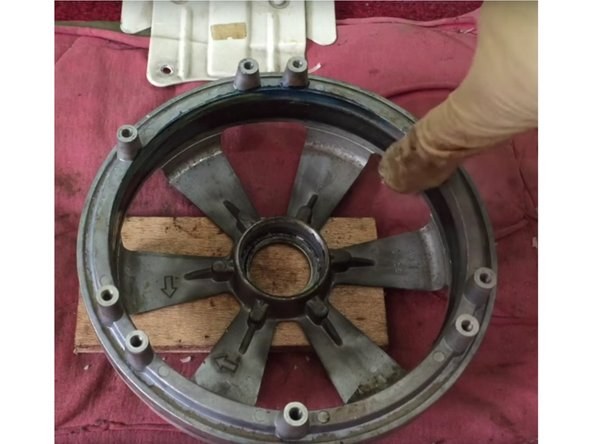Mechanical grease is apply around the inner wall of the iron cage