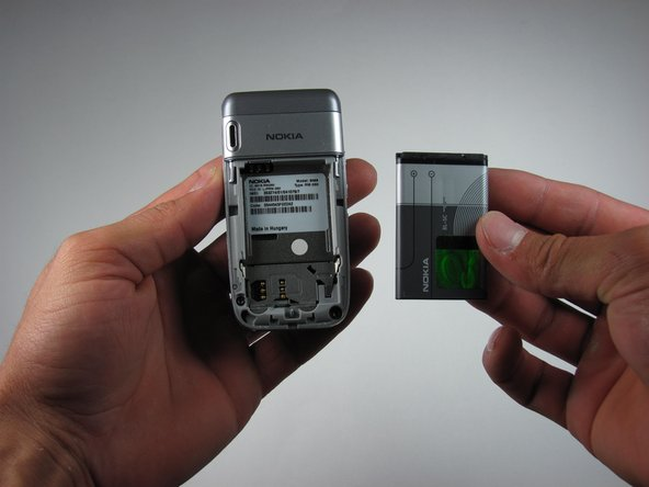 Image 3/3: Carefully lift the battery out of the phone.