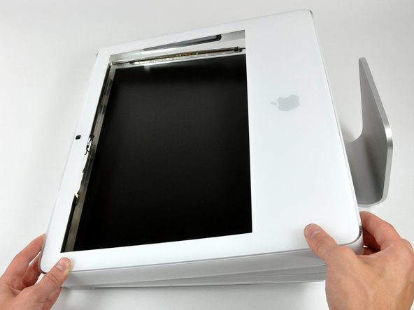 Image 1/1: Lift the front bezel from its lower edge and rotate it away from the rest of your iMac, minding the RAM arms that may get caught.