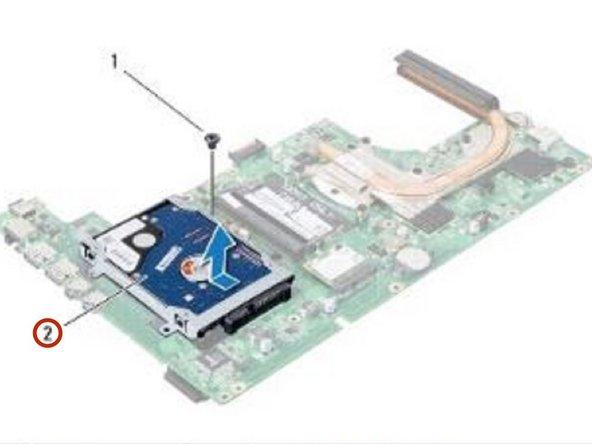 Deslice y desconecte el conjunto de la unidad de disco duro del conector en la placa del sistema como se indica en la ilustración.