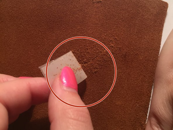 After the glue has dried, remove the tape over the tear completely and be careful.