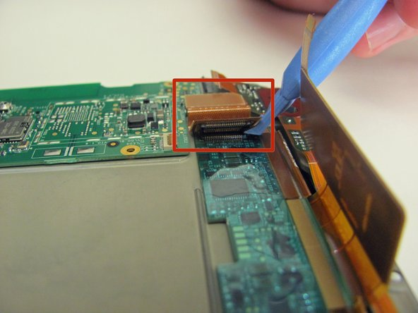 The final connection is a large orange ribbon cable that connects to an entirely separate circuit board.