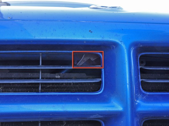 Locate the hood release latch. It can be seen through the passenger side hood grill near the top center.