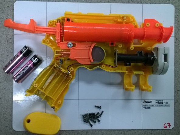 Lift the side of the blaster off exposing its internal parts.