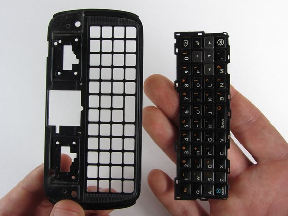 Turn keyboard holder over and allow the keyboard to simply fall out into your hand.