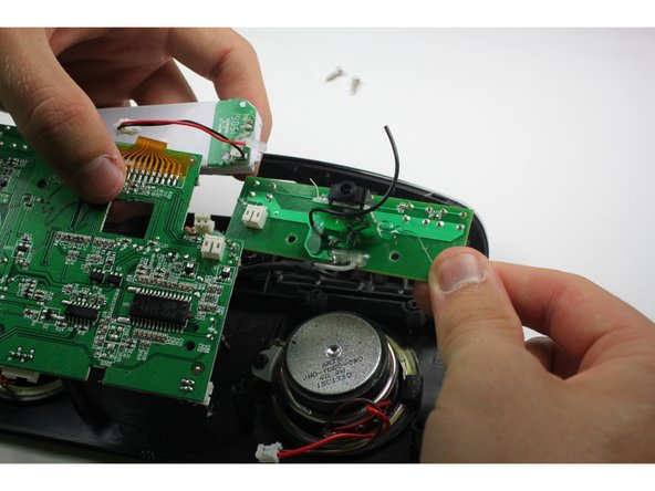 Image 1/1: Lift the LCD screen up together with the circuit board.