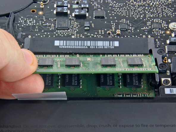 Image 1/1: Repeat this process if a second RAM chip is installed.