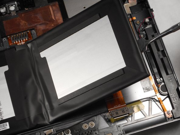 Use the nylon or metal spudger to pry the battery from the back panel.